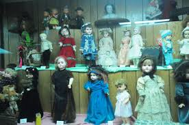 "What do you mean ""Incinerate them""? These creepy dolls should be on display!"