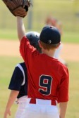 21742969-little-league-baseball-boy-playing-first-base