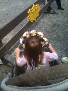 She needed a flower hat, and I needed an adorable child. When worlds collide like that, hats are bought.